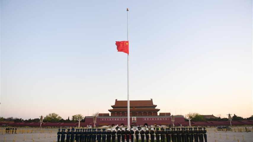 Chinese national flag flies at half-mast to mourn for people died in COVID-19 fight